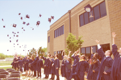 Graduates of The Vanguard School celebrate by tossing their caps in the air